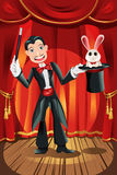 Magician. A vector illustration of a magician performing on a stage Stock Images