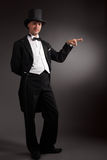 Magician. In suit on grey Stock Images