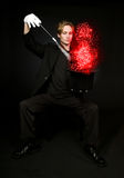 Magician. Young male magician performing a magic trick Royalty Free Stock Photos