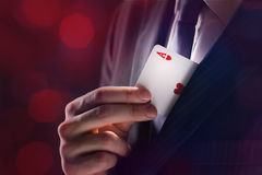 The Magician. With ace card hidden under the jacket Royalty Free Stock Photos