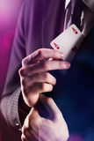The Magician. With ace card hidden under the jacket Royalty Free Stock Image