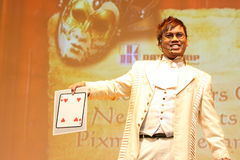 Magician In Action of Card Trick Stock Images