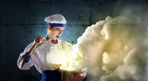 She is magician as cook Royalty Free Stock Images