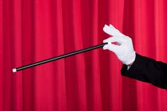 A Magician In A Black Suit Stock Image