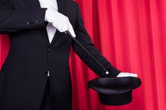A magician in a black suit Royalty Free Stock Images