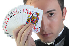 Magician and cards Stock Images