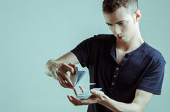 Magician with cards. Magician showing the cards for pose royalty free stock image