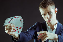 Magician with cards. Magician showing the cards for pose stock photo
