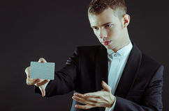 Magician with cards. Magician showing the cards for pose stock image