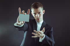 Magician with cards. Magician showing the cards for pose Stock Photography