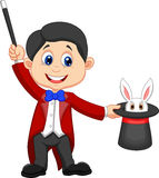 Magician cartoon pulling out a rabbit from his top hat Royalty Free Stock Image