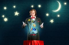 Magician casts a spell Royalty Free Stock Image