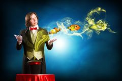 Magician casts a spell Royalty Free Stock Photo
