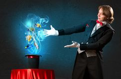 Magician casts a spell Royalty Free Stock Photos