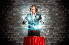 Magician causes the magic out of the hat Royalty Free Stock Photography