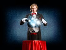 Magician causes the magic out of the hat Stock Photo