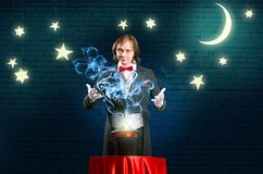 Magician causes the magic out of the hat Stock Photography