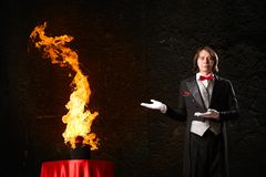 Magician. Conjures a stream of fire out of the hat Stock Image