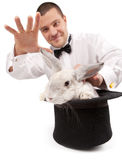 Magician Conjuring With A Rabbit Royalty Free Stock Photo