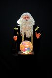 Magician and crystal ball. Magician with crystal ball is looking at viewer Stock Images
