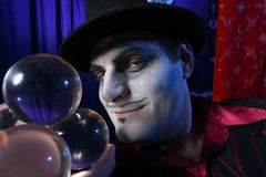 Magician with crystal balls Stock Photography