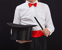 Magician detail - closeup on magic hat and wand royalty free stock photography