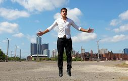 Magician at Detroit Michigan doing street magic in abandoned building at the motor city. During summer. Handsome guy in the streets stock images