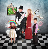 Magician Family with Tricks and Games. A family is performing magic tricks with a magician and cards for a humor or halloween concept stock photos
