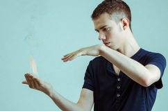 Magician with fire. Magician looking at fire for pose Royalty Free Stock Image