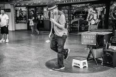 Magician at Fremont Street Experience. Portrait of a Magician performing magic trick at Fremont Street in Las Vegas royalty free stock photos