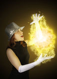 Magician Girl. A magician girl creating a lighting effect Stock Photo