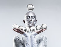 Magician with Glass Balls Stock Photography