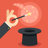 Magician hand holding magic wand over cylinder hat flat design vector illustration Stock Photos
