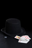 Magician hat wand and cards Royalty Free Stock Photography