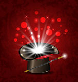 Magician hat, wand and magical glow Royalty Free Stock Photos