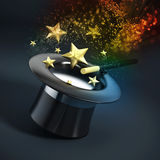 Magician hat with wand and sparkles Stock Image