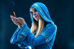 Magician holding flame Royalty Free Stock Photography