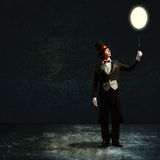 Magician holding a glowing balloon Stock Photo