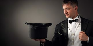 Magician holding hat, showing focus. Juggles royalty free stock photo