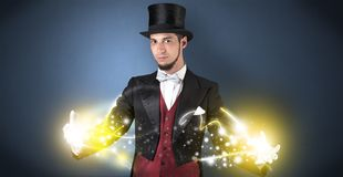 Magician holding his power on his hand Stock Images