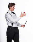A magician holding  magic balls and wand Royalty Free Stock Photos