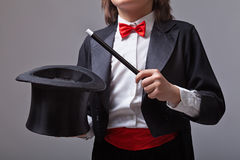 Magician holding magic hat and wand stock photo