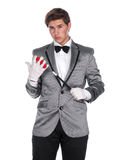 A magician holding a magic wand and balls Royalty Free Stock Photos