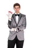 A magician holding a magic wand and balls Stock Photos
