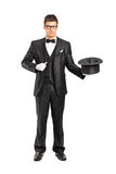 Magician holding a magic wand and top hat Stock Photography