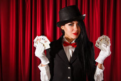 Magician holding a playing cards Stock Images
