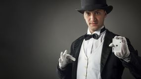 Magician holding playing cards stock images