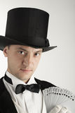 Magician holding playing cards Stock Image