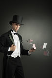 Magician holding playing cards Royalty Free Stock Images