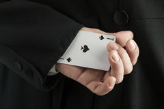 Magician holding playing cards Royalty Free Stock Photo